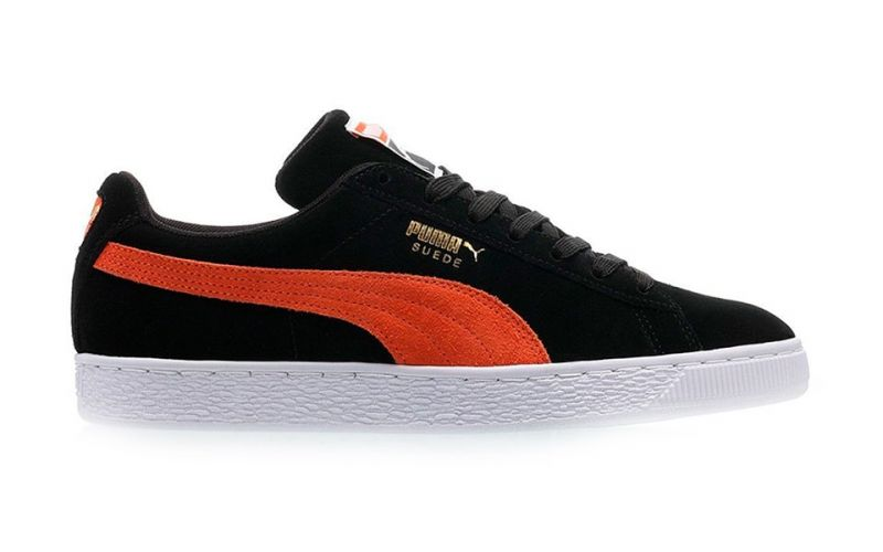 separation shoes 8410b 712a2 Puma Suede Classic black orange - Casual type of sneakers