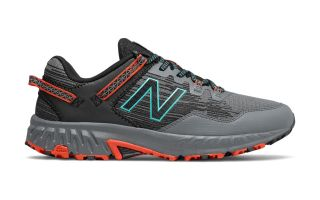 New Balance 410 GRIS NARANJA MT410RC6