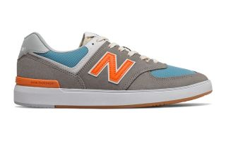 New Balance ALL COASTS 574 GRIS NARANJA AM574PGO